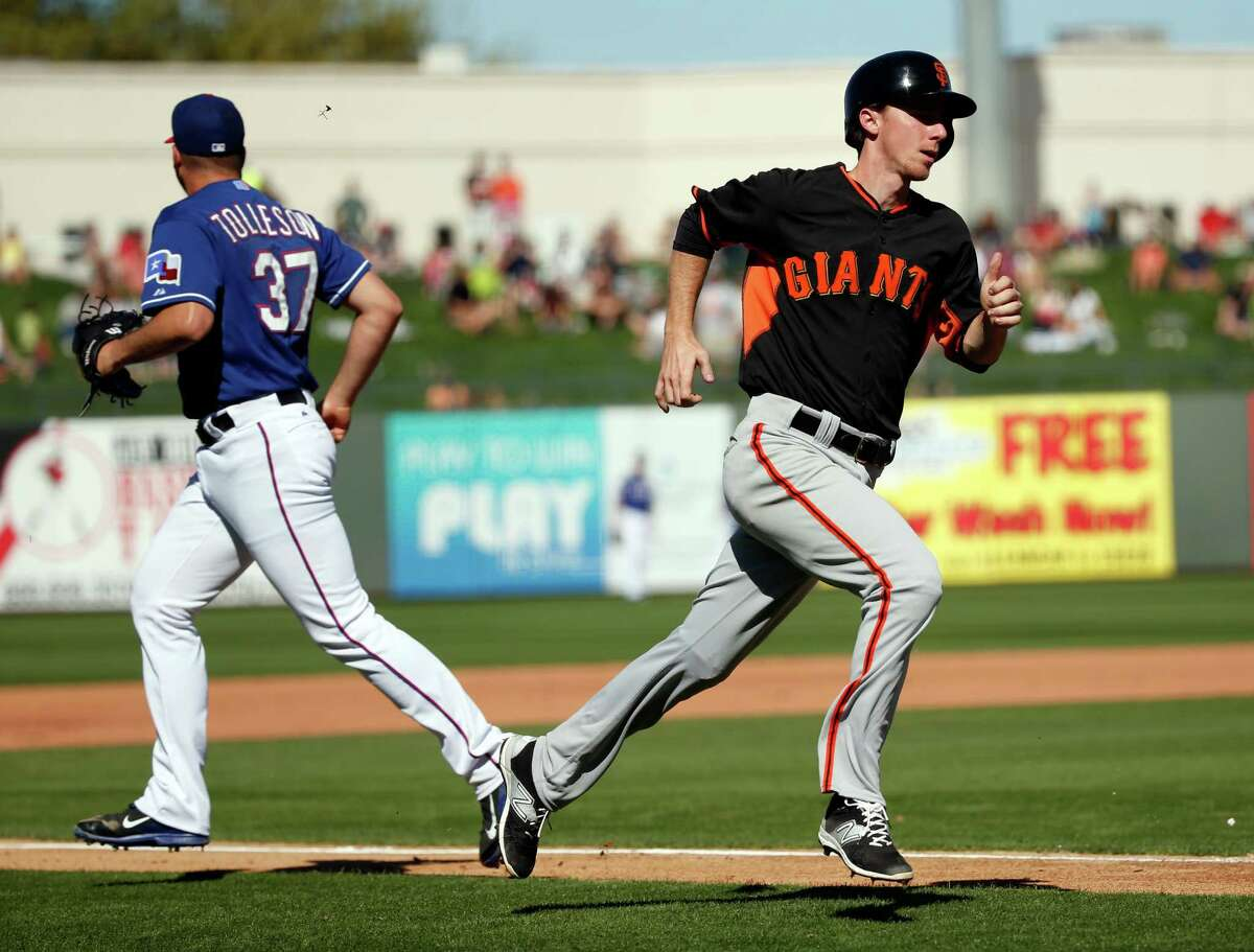 Giants infielder Matt Duffy scores on Juan Perez's two-run double in the fifth inning against the Texas Rangers in a spring training game at Surprise Stadium in Surprise, Ariz., on March 6.