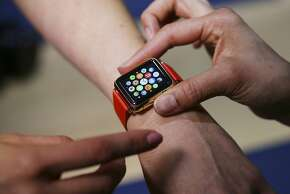 An attendees of Apple's media event tries on the Apple Watch in San Francisco, March 9, 2015. Because a smart watch is both gadget and fashion accessory, Apple designed its device to be highly customizable to suit the tastes of various consumers, from fitness buffs to collectors of luxury watches. (Jim Wilson/The New York Times)