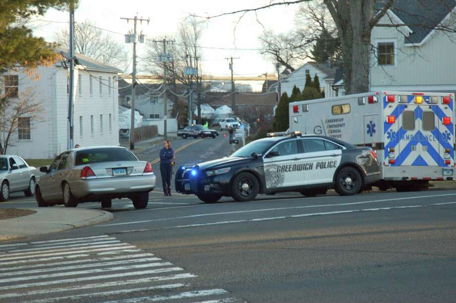 Greenwich emergency responders closed off part of River Road Monday in response to a call that turned out to have been faked. Photo: Ken Borsuk / Greenwich Time