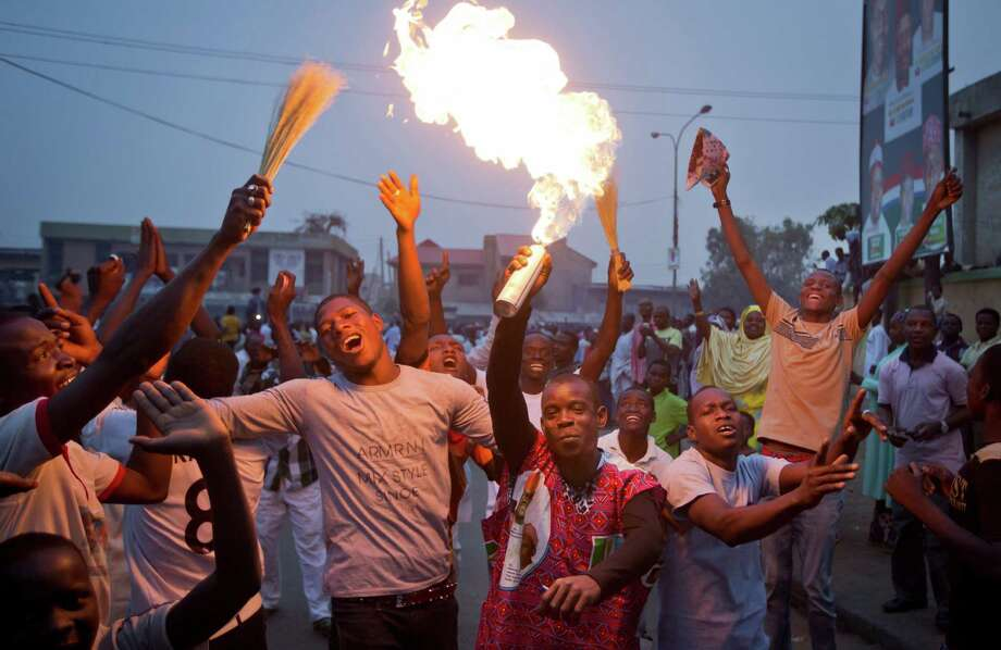 Supporters of opposition candidate Muhammadu Buhari celebrate an anticipated win for their candidate, in Kano, Nigeria, Tuesday. President Goodluck Jonathan was said to have called challenger Muhammadu Buhari to concede. Photo: Ben Curtis, STF / AP