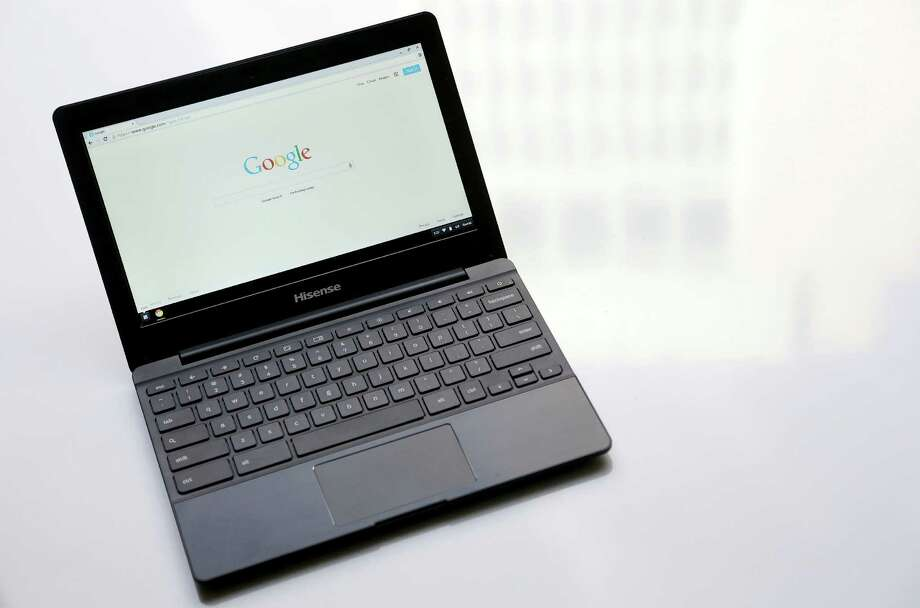 This Monday, March 30, 2015 photo shows a Hisense Chrome laptop in San Francisco. Google and Microsoft are releasing cheaper laptops and tablets in an effort to reach students, budget-conscious families and overseas markets. (AP Photo/Jeff Chiu)  ORG XMIT: NYBZ124 Photo: Jeff Chiu / AP