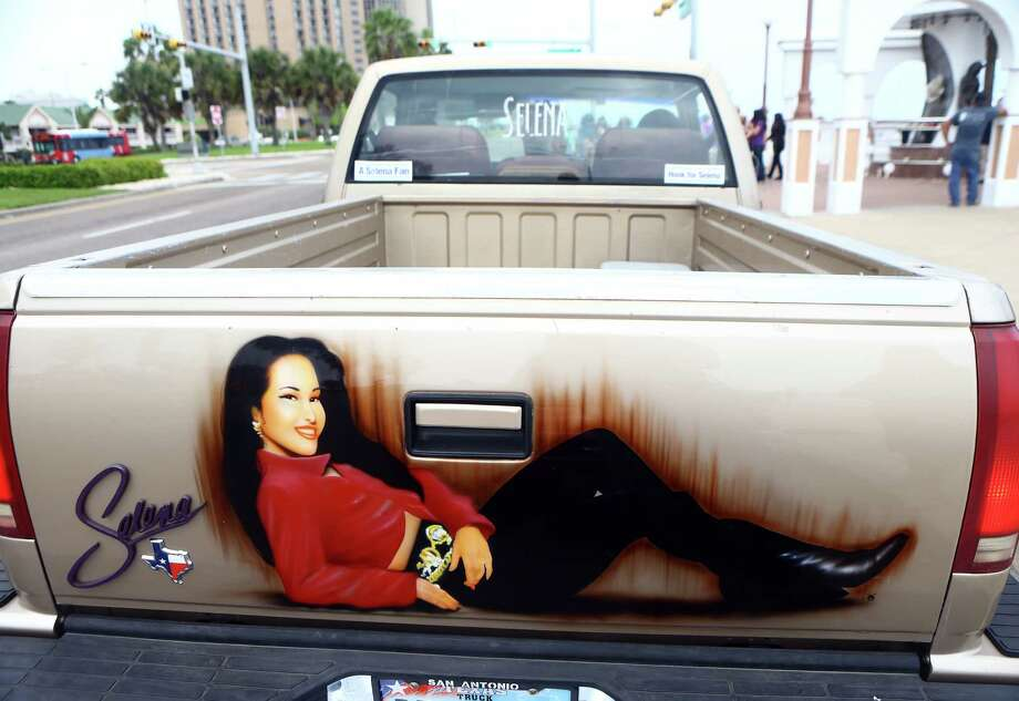 A painting of Selena Quintanilla-Pérez appears on the back of a truck on Tuesday, March 31, 2015, in Corpus Christi, Texas, as fans gather to remember the Latin pop star on the 20th anniversary of her death. Photo: Gabe Hernandez, Associated Press / Corpus Christi Caller-Times