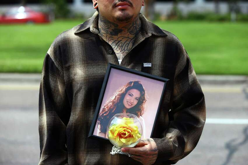 Gus Salazar holds a photo of Selena Quintanilla-Pérez on Tuesday, March 31, 2015, in Corpus Christi, Texas, as gathered to remember the Latin pop star on the 20th anniversary of her death.