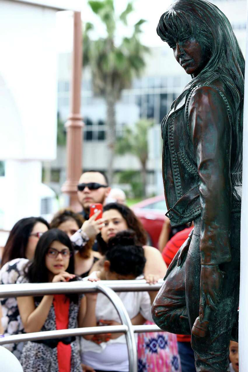 Fans gather in front of the Selena Memorial Statue for a moment of silence on Tuesday, March 31, 2015, in Corpus Christi, Texas, to remember the Latin pop star on the 20th anniversary of her death.
