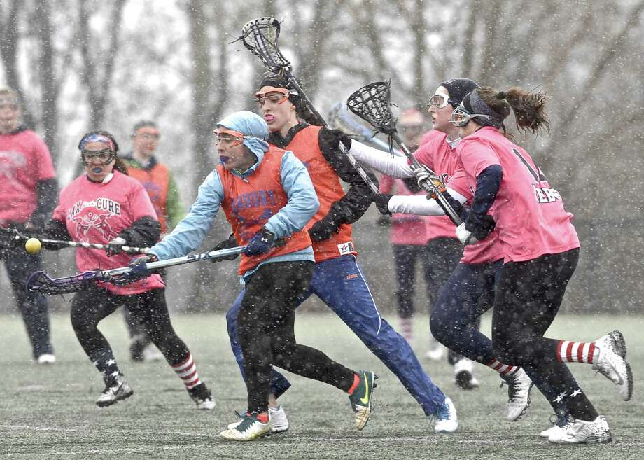 Danbury's Laurie Stark, in hood, reaches for the ball during the girls high school lacrosse scrimmage between Danbury and New Fairfield high schools on Tuesday, March 31, 2015, played at New Fairfield High School, in New Fairfield, Conn. Photo: H John Voorhees III / The News-Times