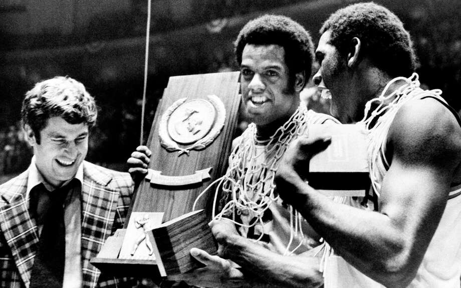 Indiana coach Bobby Knight and team members Scott May (center) and Quinn Buckner celebrate with the trophy after winning the 1976 NCAA basketball championship in Philadelphia. The Hoosier beat Michigan 86-68. Photo: AP /Associated Press / AP