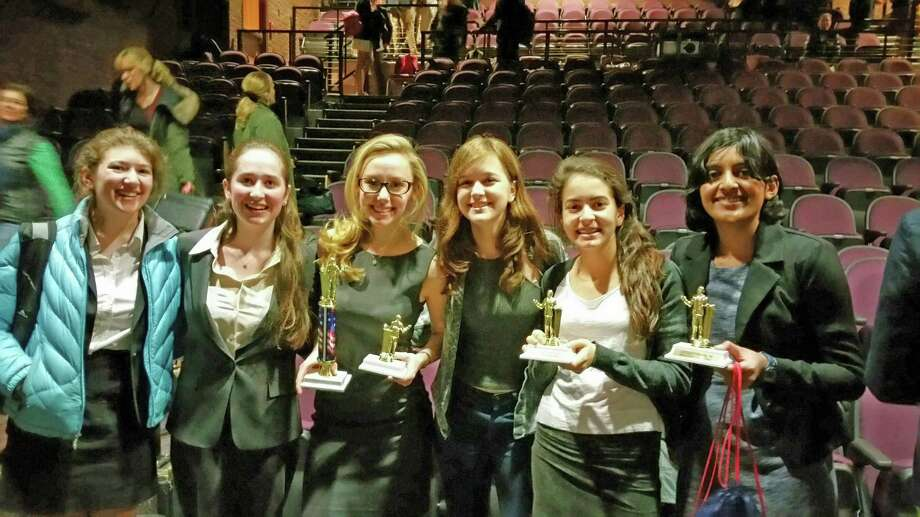 Greenwich High School Debate Team members, from left: Izzy Baird, Alexandra Maloney, Olivia Scharfman, Alexis Tatore, Emily Philippedes and Shobhita Sundaram pose at the state championships at Wilton High School Saturday. Photo: Contributed Photo / Greenwich Time Contributed
