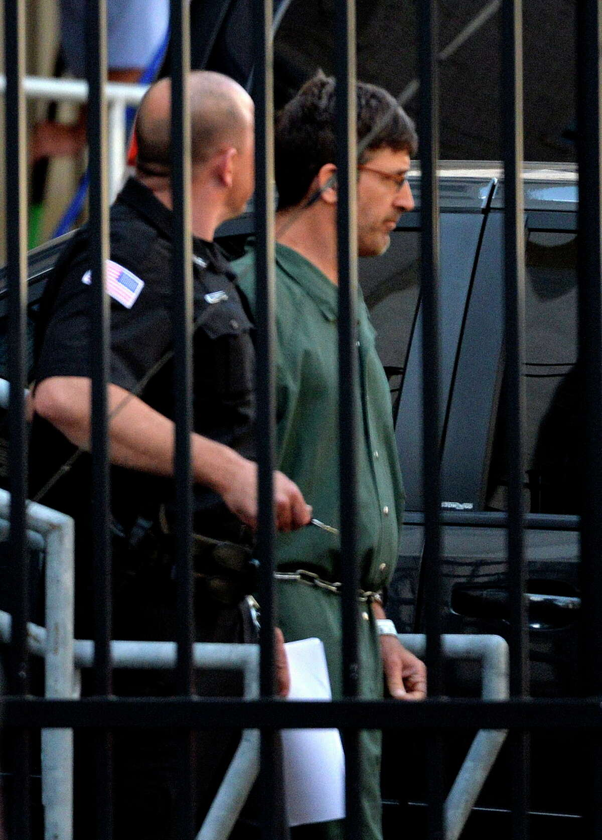 Glendon Scott Crawford leaves the federal courthouse in shackles after being arraigned Wednesday afternoon, June 19, 2013, in Albany, N.Y. (Skip Dickstein/Times Union archive)
