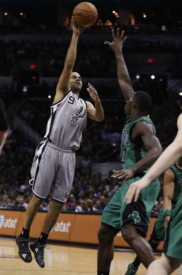 Spurs' Tony Parker (09) attempts a shot against Boston Celtics' Brandon Bass (30) during their game at the AT&T Center on Friday, Mar. 20, 2015. (Kin Man Hui/San Antonio Express-News) Photo: Kin Man Hui, San Antonio Express-News