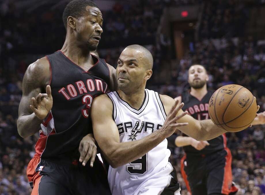Tony parker moves in on James Johnson as the Spurs host the Toronto Raptors at the AT&T Center  on March 10, 2015. Photo: Tom Reel, San Antonio Express-News