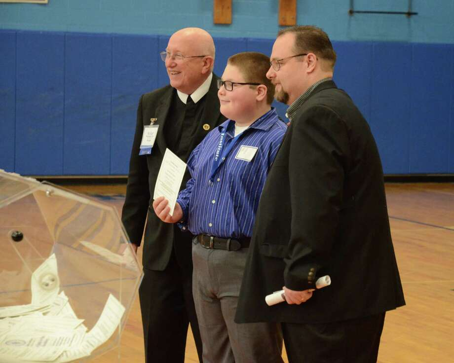 At La Salle Institute?s Open House on Sunday, March 22, the school gave away a year of tuition to a future student. The winner?s name, pulled from a raffle, is A.J. Pennacchio, who stands with Brother Carl Malacalza, left, and his father, Anthony Pennacchio, right. (Tom Reuter) Photo: Thomas Reuter                        / Copyright Thomas Reuter 2015