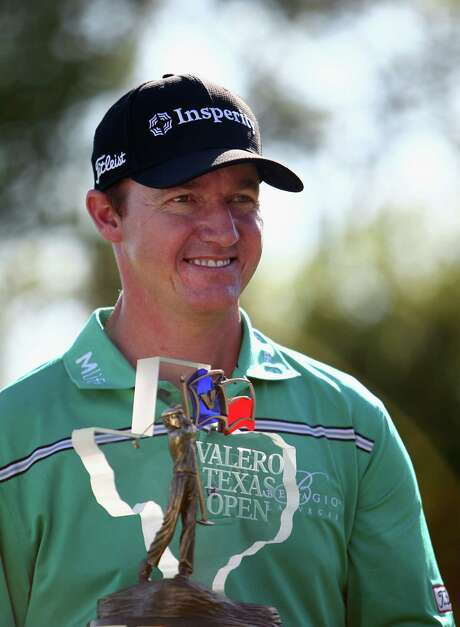 SAN ANTONIO, TX - MARCH 29:  Jimmy Walker poses with the Valero Texas Open trophy after winning in the final round at TPC San Antonio AT&T Oaks Course on March 29, 2015 in San Antonio, Texas.  (Photo by Marianna Massey/Getty Images) Photo: Marianna Massey, Stringer / 2015 Getty Images