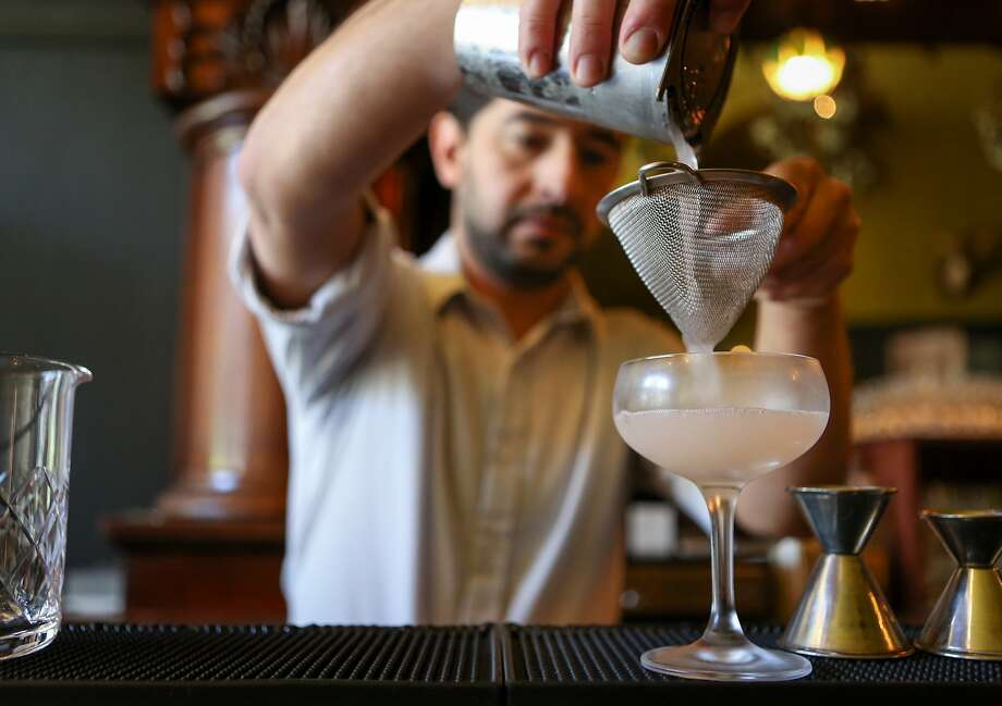 Bar manager, Tamir Benshalom, of Bull Valley Roadhouse mixes up his pre-prohibition inspired drink, the Lost Costa cocktail in Port Costa, Calif., on Wednesday, March 25, 2015. Photo: Amy Osborne, The Chronicle