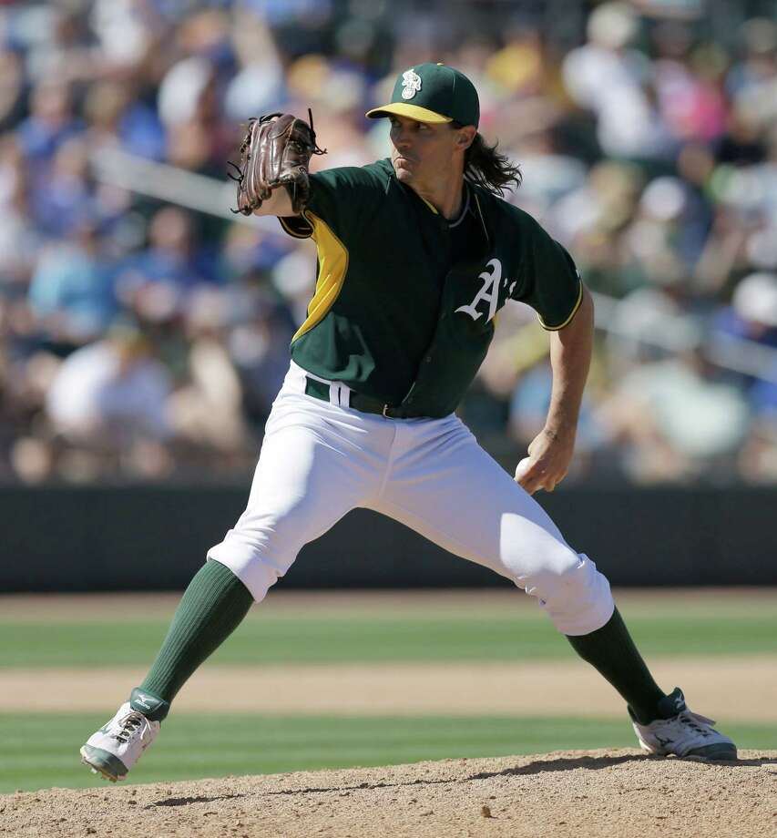 Oakland Athletics' Barry Zito works against the Chicago Cubs in the fourth inning of a spring training exhibition baseball game Tuesday, March 24, 2015, in Mesa, Ariz. (AP Photo/Ben Margot) Photo: Ben Margot / Associated Press / AP