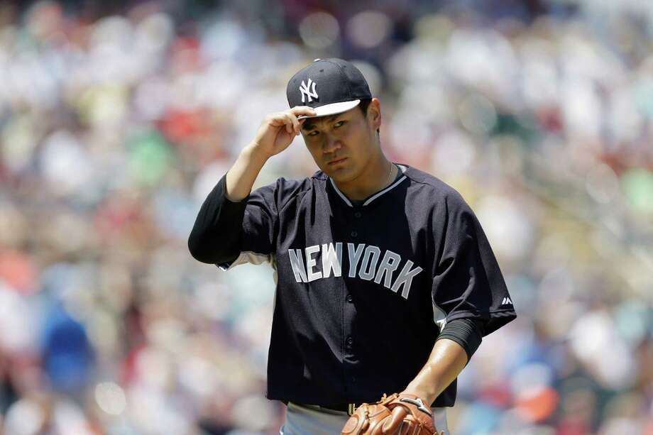 New York Yankees starting pitcher Masahiro Tanaka, walks off the field after he delivers against the Minnesota Twins in the second inning during an exhibition spring training baseball game, Tuesday, March 31, 2015, in Fort Myers, Fla. (AP Photo/Brynn Anderson) ORG XMIT: FLBA109 Photo: Brynn Anderson / AP