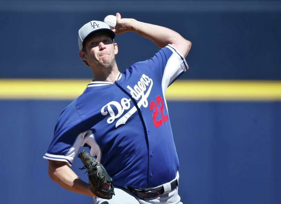 FILE - In this March 15, 2015, file photo, Los Angeles Dodgers starting pitcher Clayton Kershaw works against the Seattle Mariners in the first inning of a spring training baseball game in Peoria, Ariz. The average salary when opening-day rosters are finalized Sunday will break the $4 million barrier for the first time, according to a study of all major league contracts by The Associated Press. Dodgers pitcher Clayton Kershaw tops players at $31 million and Los Angeles leads teams at nearly $273 million, easily a record.(AP Photo/Lenny Ignelzi, File) ORG XMIT: NY174 Photo: Lenny Ignelzi / AP