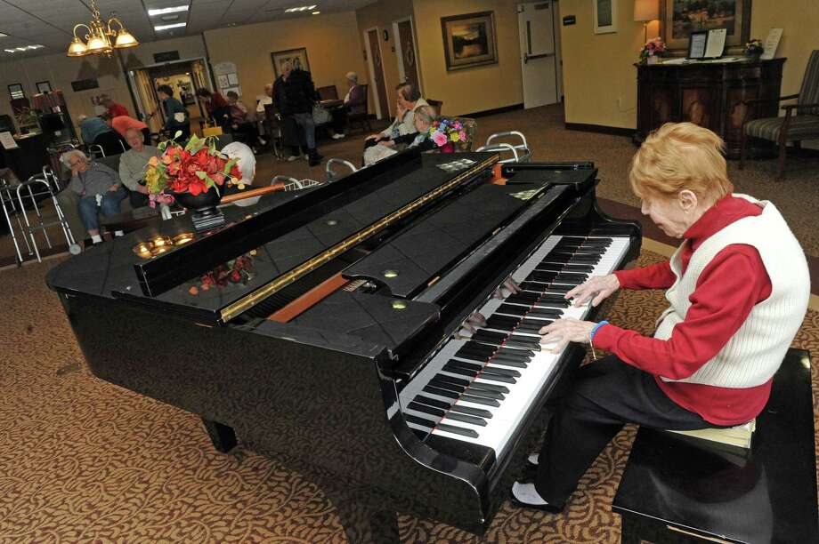 Legendary jazz pianist Lee Shaw plays piano for fellow residents at the Emeritus of Colonie Manor on Tuesday March 31, 2015 in Latham, N.Y. (Michael P. Farrell/Times Union) Photo: Michael P. Farrell / 00031213A