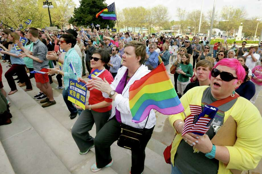 Barbara Hall of Little Rock, far right, on Tuesday demonstrates with about 200 others against a religious liberty law at the Arkansas state Capitol. Photo: Danny Johnston, STF / AP