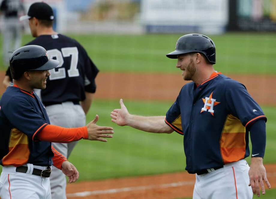 Jose Altuve, left, congratulates Robbie Grossman, who has hit .326 this spring in a bid to make the team in a reserve role. Photo: DG, STF / AP