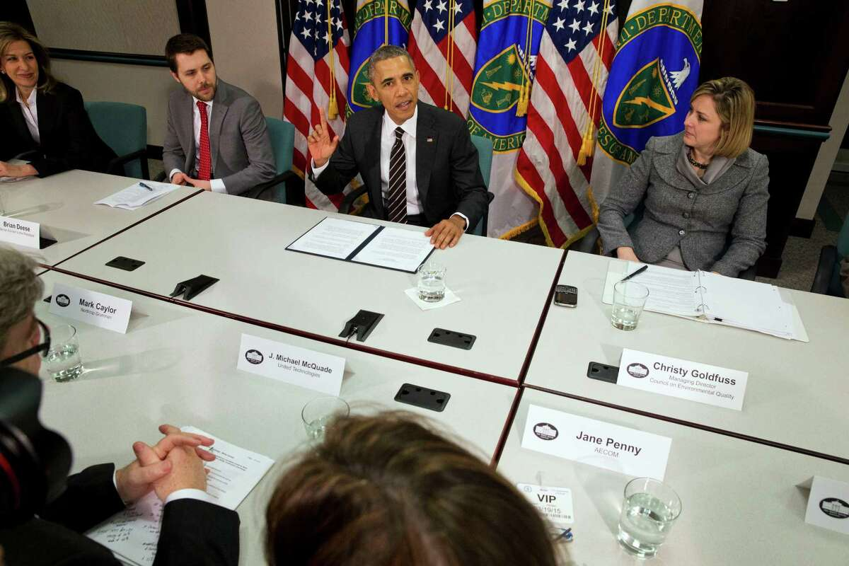 President Barack Obama, flanked by senior adviser Brian Deese (left) and Christina Goldfuss, managing director of the Council on Environmental Quality, announces the United States will pledge to cut its greenhouse gas emissions by up to 28 percent.