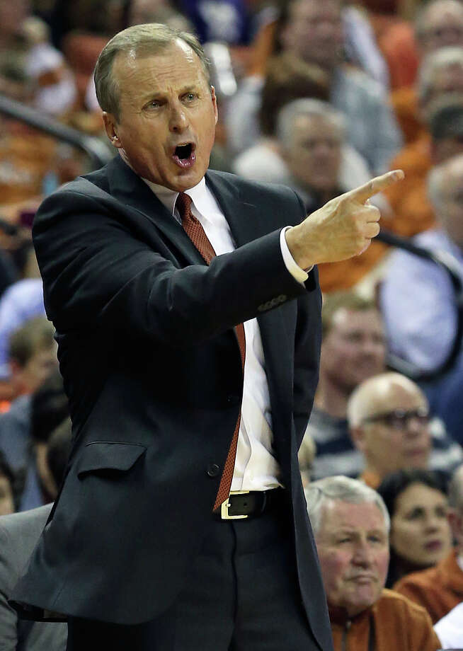 Coach Rick Barnes directs his team as the Longhorns host Kansas State at the Erwin Center on March 7, 2015. Photo: Tom Reel