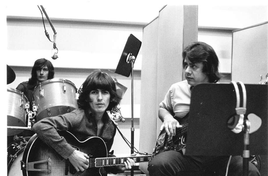 "George Harrison, center, is seen here with Steve Winwood (behind the drums) and Wrecking Crew guitarist Joe Osborn. The Wrecking Crew was a group of studio musicians who contributed anonymously to hundreds of  hits in the 1960s. They played on chart toppers for everyone from The Beach Boys to Sonny and Cher. Their story is told in a 2008 documentary that will be screened in Bethel as part of a new film festival. The documentary is called ""The Wrecking Crew."" Photo: Contributed Photo / The News-Times Contributed"