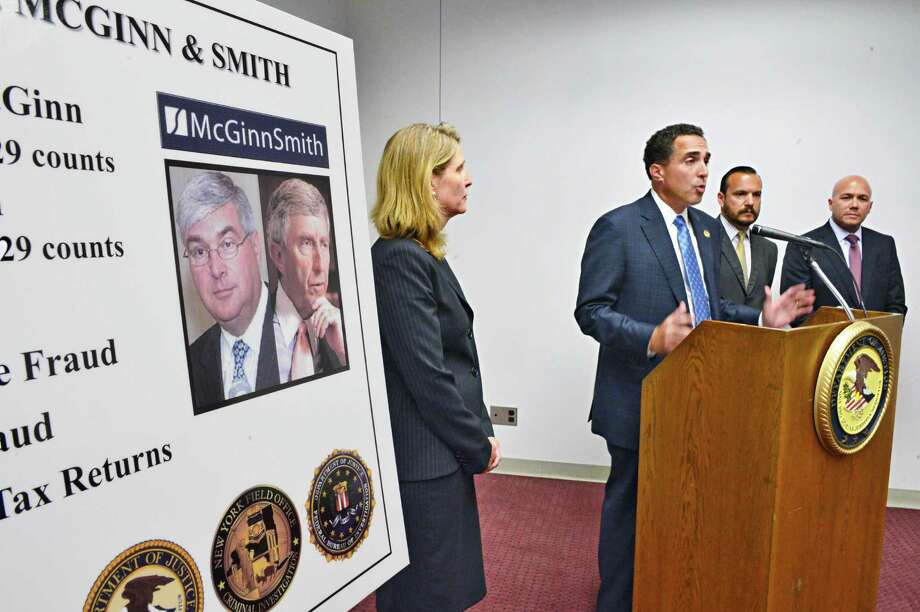 U.S. Attorney Richard Hartunian, at podium, speaks during a news conference following sentencing of former Albany brokers Timothy M. McGinn and David L. Smith in U.S. District Court Wednesday, Aug. 7, 2013, in Utica, N.Y.  (John Carl D'Annibale / Times Union archive) Photo: John Carl D'Annibale / 00023444A