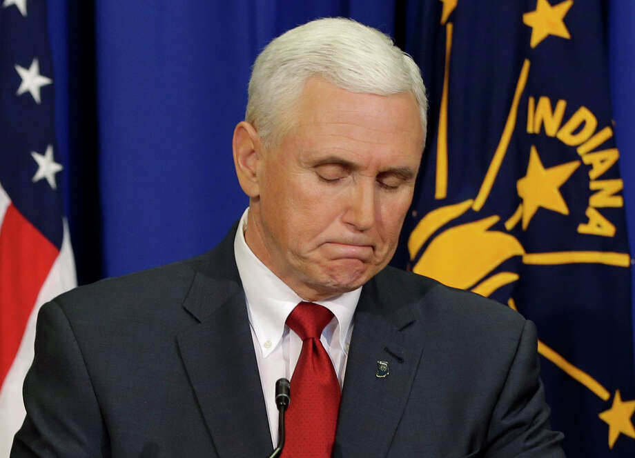 Indiana Gov. Mike Pence listens to a question during a news conference, Tuesday, March 31, 2015, in Indianapolis. Pence said that he wants legislation on his desk by the end of the week to clarify that a new religious-freedom law does not allow discrimination. The law has triggered an outcry, with businesses and organizations voicing concern and some states barring government-funded travel to the Midwestern state. (AP Photo/Darron Cummings) ORG XMIT: INDC208 Photo: Darron Cummings / AP