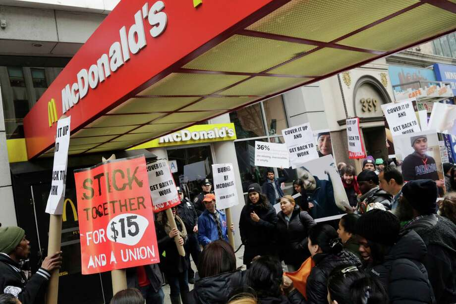 Fast-food workers protest workplace conditions last month in New York.  Photo: Mark Lennihan, STF / AP