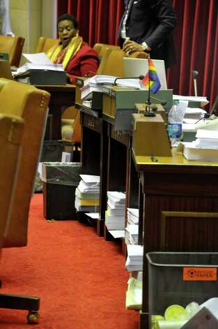 Some of the budget bills are seen stacked up under the desks of members of the Assembly  at the Capitol on Tuesday, March 31, 2015, in Albany, N.Y.    (Paul Buckowski / Times Union) Photo: PAUL BUCKOWSKI / 00031245A