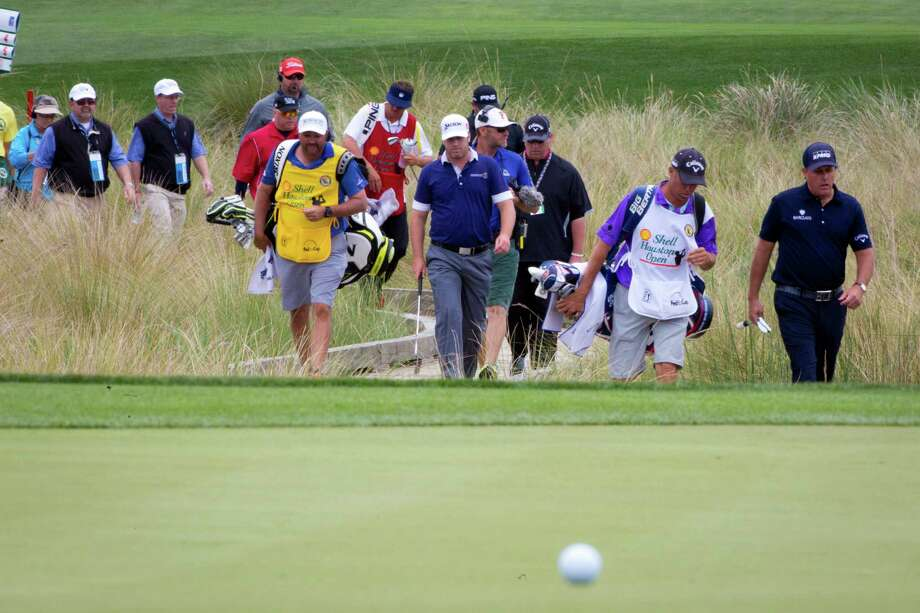 The caddie for a high-profile player like Phil Mickelson, right, gets plenty of time on television wearing the bib of the sponsors of various tournaments, and the caddies feel they should be compensated for being walking billboards. Photo: Marie D. De Jesus, Staff / © 2014 Houston Chronicle