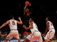 NEW YORK, NY - MARCH 31:   Sheldon McClellan #10 of the Miami (Fl) Hurricanes shoots over the Temple Owls defense during the NIT Championship semifinals at Madison Square Garden on March 31, 2015 in New York City.  (Photo by Jeff Zelevansky/Getty Images) ORG XMIT: 537113193