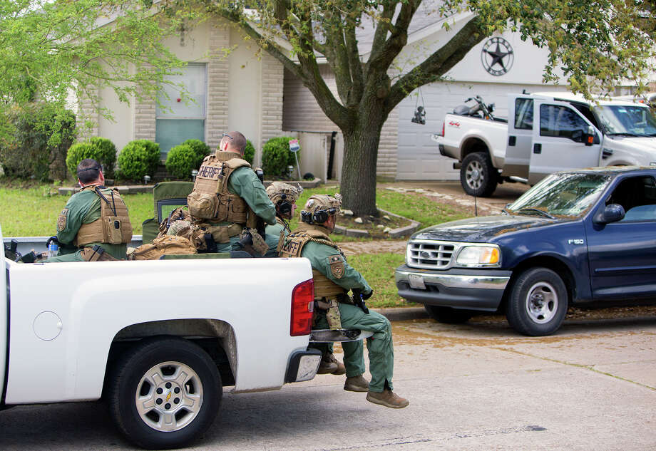 The Harris County Sheriff's Department works a SWAT scene in the 21900 block of Breezy Hill Drive, Tuesday, March 31, 2015, in Katy. (Cody Duty / Houston Chronicle) Photo: Cody Duty, Staff / © 2015 Houston Chronicle