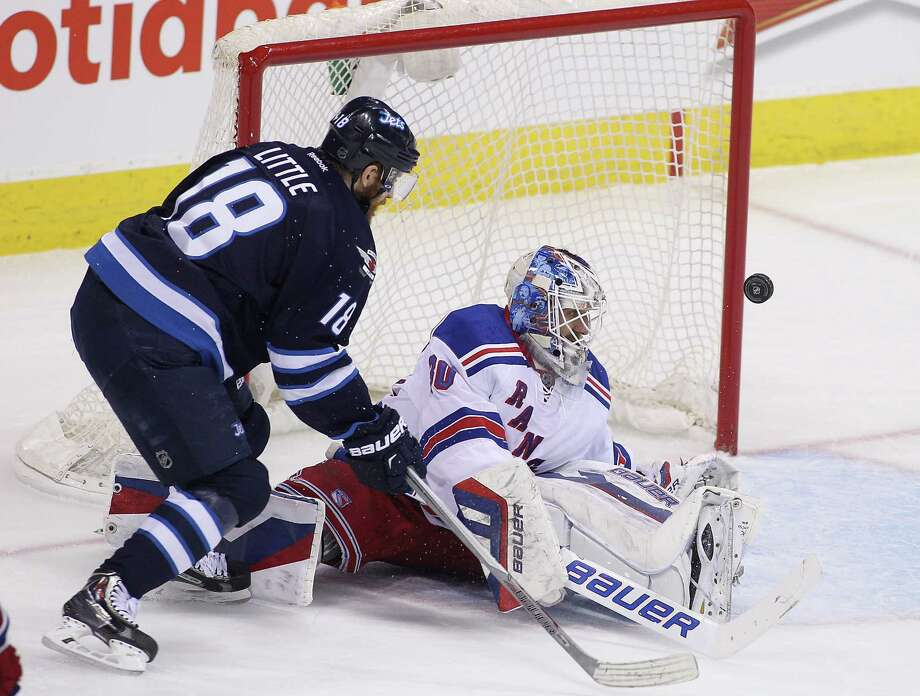 WINNIPEG, MB - MARCH 31:  Henrik Lundqvist #30 of the New York Rangers blocks a shot on goal by Bryan Little #18 of the Winnipeg Jets in first period action in an NHL game at the MTS Centre on March 31, 2015 in Winnipeg, Manitoba, Canada. (Photo by Marianne Helm/Getty Images) ORG XMIT: 507051267 Photo: Marianne Helm / 2015 Getty Images