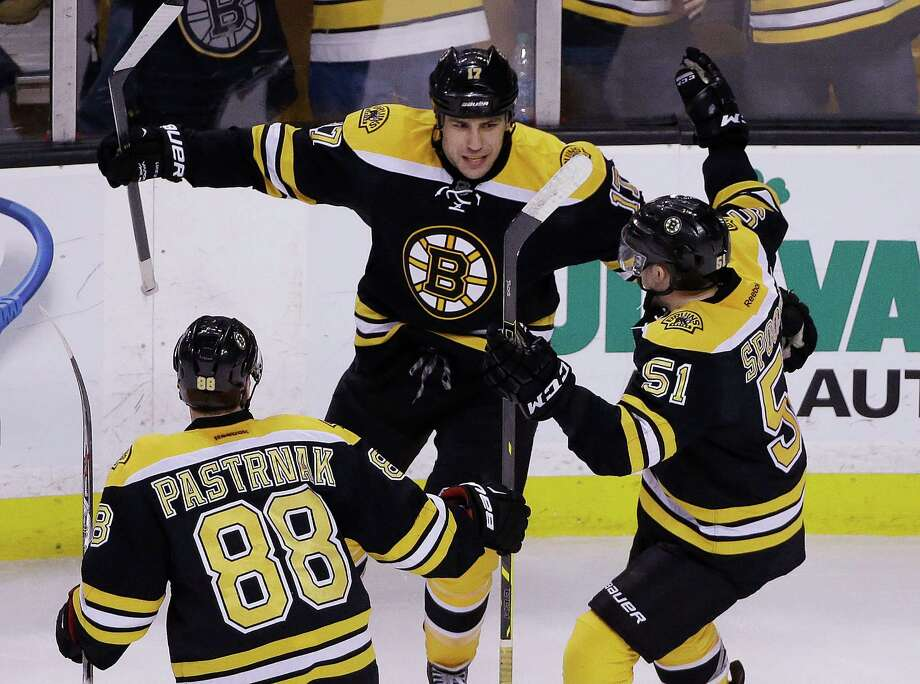 Boston Bruins left wing Milan Lucic (17) celebrates his go-ahead goal against the Florida Panthers with teammates David Pastrnak (88) and Ryan Spooner (51) during the third period of an NHL hockey game in Boston Tuesday, March 31, 2015. The Bruins won 3-2. (AP Photo/Elise Amendola) ORG XMIT: MAEA106 Photo: Elise Amendola / AP
