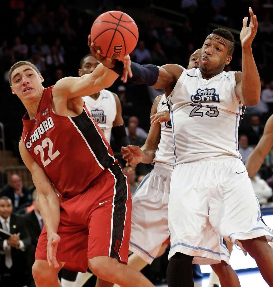 Stanford forward Reid Travis (left) and Old Dominion forward Richard Ross vie for control of the ball during the second half of their NIT semifinal. Photo: Frank Franklin II / Associated Press / AP