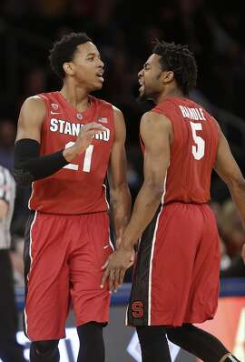 Stanford's Anthony Brown (21) and Chasson Randle (5) celebrates after Brown made a 3-point basket during the first half of a semifinal against Old Dominion at the NIT college basketball tournament Tuesday, March 31, 2015, in New York. (AP Photo/Frank Franklin II)