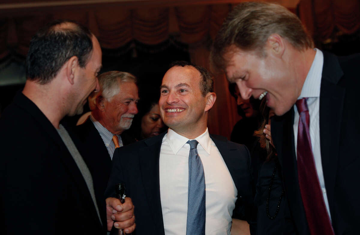 Evan Marwell (center), CEO and founder of Education Superhighway, reacts after being named the San Francisco Chronicle's Visionary of the Year recipient at the Fairmont Hotel, Tuesday, March 31, 2015, in San Francisco, Calif.