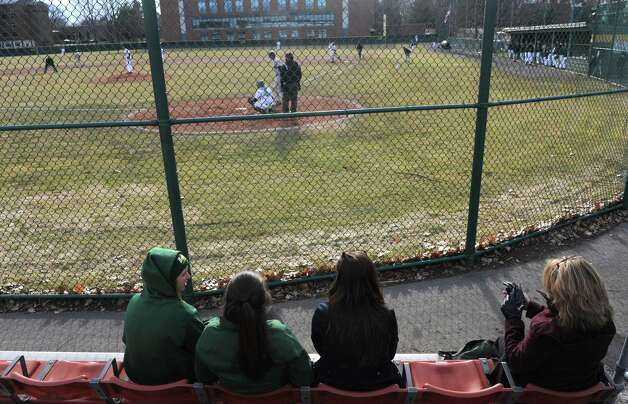 Dressed for a chill fans watch the Siena vs Army college baseball game on Tuesday March 31, 2015 in Loudonville, N.Y. (Michael P. Farrell/Times Union) Photo: Michael P. Farrell / 00031246A