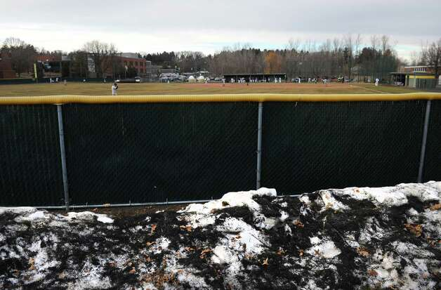 Unmelted snow piles surrond the ground beyond the outfieled fence during the Siena vs Army college baseball game on Tuesday March 31, 2015 in Loudonville, N.Y. (Michael P. Farrell/Times Union) Photo: Michael P. Farrell / 00031246A