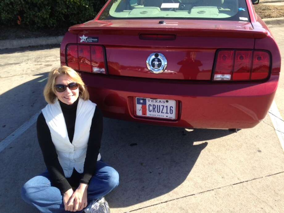 "San Antonio woman Deborah Wall poses with her Ford Mustang bearing license plates with the phrase ""CRUZ16"" in support of U.S. Sen. Ted Cruz, R-Texas, who announced his intent to run for president on March 23. The back license plate also features an autograph from Cruz. Wall later stuck the plates on her 2015 Ford Mustang. Photo: Courtesy Of Deborah Wall"