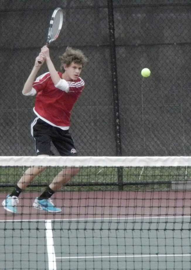 Warde's Jack Johnson returns a shot during a match against Ludlowe last spring. Johnson, a senior, is one of the top returning players for Mustangs coach John Harvey this season. Photo: Reid L. Walmark / Fairfield Citizen