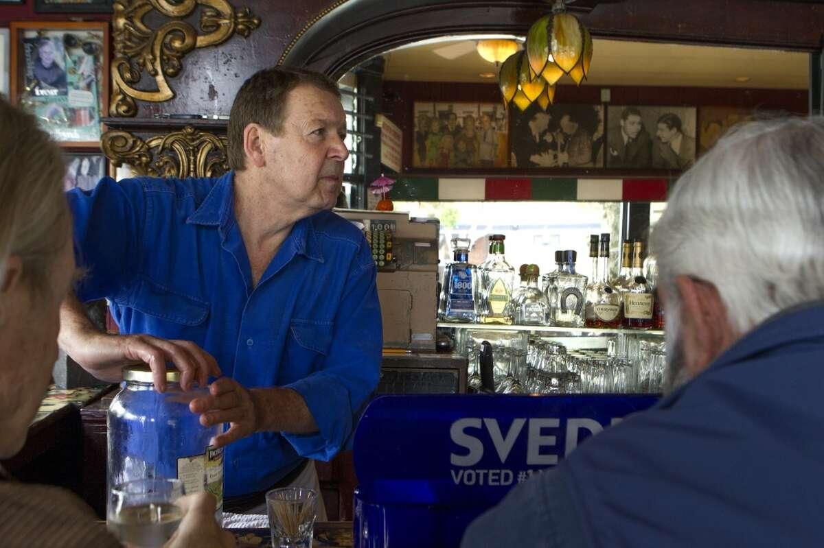 Bartender Randy Harris takes a customer's order at Capp's Corner, Friday, March 27, 2015, in San Francisco, Calif.