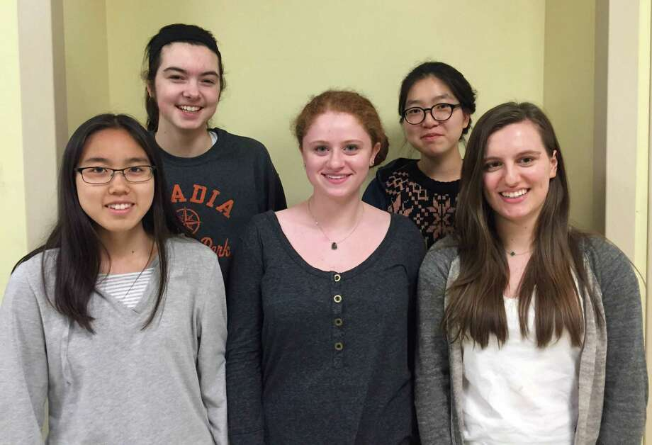 These five Staples High School mathematicians are headed to the national finals of a math contest sponsored by Moody's Corp., the financial-ratings company. The Staples team is one of six finalists picked from more than 1,100 teams nationwide. From left are Terrie Yang, Madeline Schemel, Claudia Landowne, Chai Kim and Claire Sampson. Photo: Westport News/Contributed Photo / Westport News