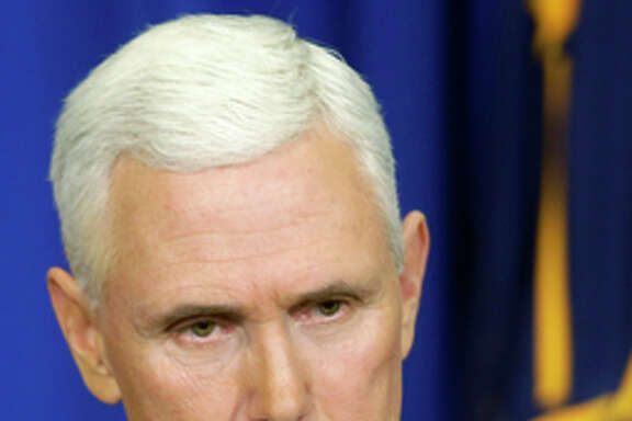 Govs. Mike Pence and Asa Hutchinson are feeling the heat.