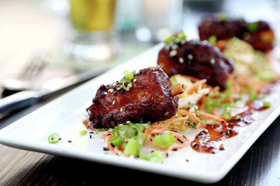 Korean Pork Lollipops - pork shanks, Korean BBQ and red chile slaw at Local Pour in the new Hughes Landing development  Tuesday, March 24, 2015, in The Woodlands, Texas. ( Gary Coronado / Houston Chronicle ) Photo: Gary Coronado, Staff / © 2015 Houston Chronicle