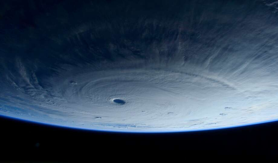 This image taken Tuesday March 31, 2015 shows Typhoon Maysak taken by astronaut Samantha Cristoforetti from the International Space Station. The Pacific Daily News newspaper in Guam reports the storm was upgraded Tuesday to a super typhoon with winds of 150 mph and was moving west-northwest at 15 mph. Officials say super Typhoon Maysak is expected to significantly weaken before reaching the Philippines around Sunday. (AP Photo/NASA, Samantha Cristoforetti) . Photo: Samantha Cristoforetti, Associated Press