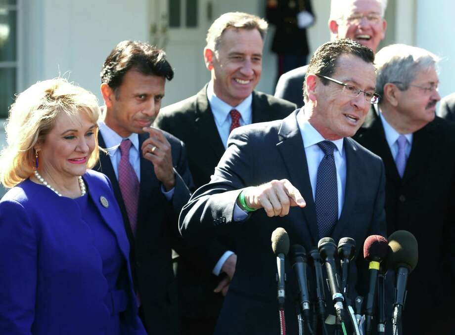 Connecticut Gov. Dannel Malloy (C) speaks while flanked by Gov. Mary Fallin, (R-OK) (L), Gov. Bobby Jindal (D-LA) (2ndL), and other members of the National Governors Association, after a meeting with President Barack Obama at the White House February 24, 2014 in Washington, DC. Photo: Mark Wilson, Mark Wilson/Getty Images / 2014 Getty Images
