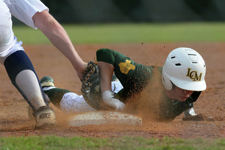 Little Cypress-Mauriceville's Vinny Hale slides safely back into first base in the Bear's match up with Hardin-Jefferson at the Hawk's stadium on Tuesday.   Photo taken Tuesday, March 31, 2015  Guiseppe Barranco/The Enterprise Photo: Guiseppe Barranco, Photo Editor