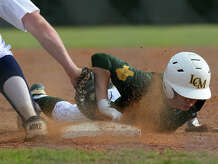 Little Cypress-Mauriceville's Vinny Hale slides safely back into first base in the Bear's match up with Hardin-Jefferson at the Hawk's stadium on Tuesday.   Photo taken Tuesday, March 31, 2015  Guiseppe Barranco/The Enterprise
